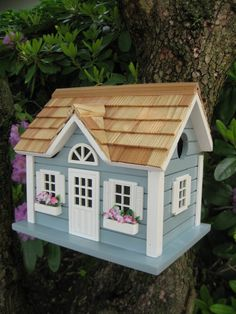 This bestseller is back in stock! The New England Summer Birdhouse is inspired by the light blue cottages that dot Nantucket and featured a two front window flower boxes and a half moon opera window! Large Bird Houses, Wooden Bird Houses, Decorative Bird Houses, Painted Houses, Exterior Grade Plywood, Nantucket Cottage, Bluebird House, Bird House Kits, House Yard