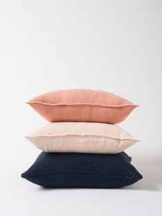 If you've been seeking luxurious textures without pattern, your quest is over. The soft, fine fabric and raw edge of this Hand Woven Linen Cushion Cover in salmon is a little live in luxury for every living room.