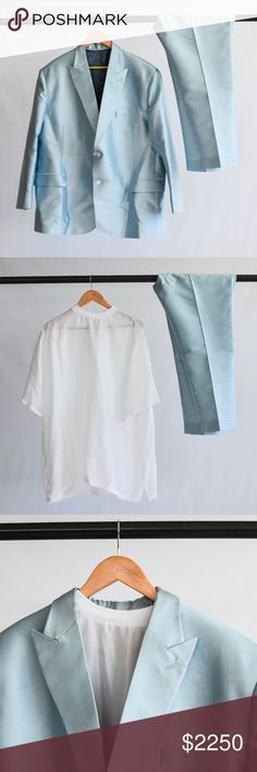 "Custom Sateen Light Blue Suit Sateen light blue custom suit designed for DJ Khaled by Terrell Jones and 5001 Flavors. 27"" waist, 34.5"" length, and 21"" shoulder measurements on jacket when laid flat. Pairs with a 2XL white undershirt with shoulder zipper detail included with suit. Pants have hook closure. Some loose threading along belt loops. Approx. 46"" waist and 28"" inseam on pants. Custom Suits & Blazers Suits"