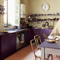 This purple kitchen is wonderful. So much can be accomplished with a coat of paint and new hardware.