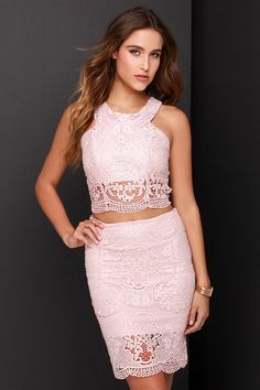 Get into double the trouble, and have twice the fun with the Double Time Blush Pink Lace Two-Piece Dress! Stunning crocheted floral lace covers a sleeveless crop top with rounded neckline, and figure-enhancing princess seams. The matching midi-length pencil skirt completes the look with a body-skimming fit, and band of sheer lace at bottom. Top and skirt have exposed gunmetal back zippers.