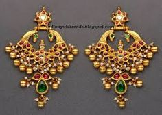 Temple Earrings in Gold with Cabochon Rubies and Emeralds. Shop for your wedding jewellery with Bridelan - a personal shopper & stylist for weddings, also a resource for finding rare jewels of India. Traditional Indian Jewellery, Traditional Earrings, Indian Jewellery Design, Jewelry Design, India Jewelry, Temple Jewellery, Gold Jewellery, Silver Jewelry, Gold Earrings Designs