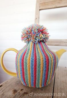 Ribbed pom-pom teapot cosy made by LuluLoves inspired by this video tutorial by bobwilson123  here http://www.youtube.com/watch?v=XJiS2rz1Le4