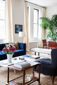 Color scheme. Bold blue couch. Warm tans, cream, wood, white, and pink (or coral). Ashe + Leandro update