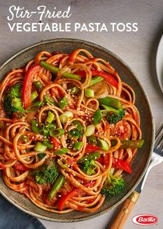 This vegetable stir-fry is a perfect weeknight meal! Save this linguine and Traditional sauce recipe, filled with red pepper, broccoli and green beans.
