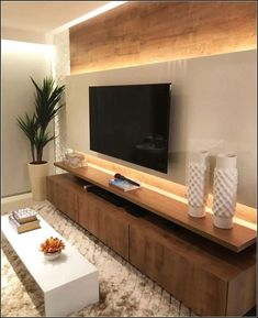 Wood backdrop and TV wall unit. Lit up TV wall unit. Sophisticated and simple TV wall mount design. Tv Wall Mount Designs, Tv Wall Design, House Design, Living Room Tv Unit Designs, Interior Design Living Room, Living Room Decor, Living Rooms, Room Interior, Modern Tv Wall Units