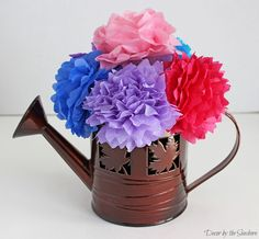 These DIY tissue paper flowers are so easy to make, and you probably already have everything you need to make them at home! Make your own tissue paper flowers to add a pop of color to your home and welcome spring! They're also the perfect party centerpiece! | decorbytheseashore.com