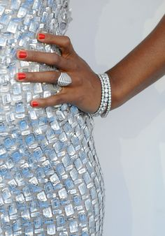 Kelly Rowland's red orange nails looked super stylish against her silver gown at the Billboard Music Awards.
