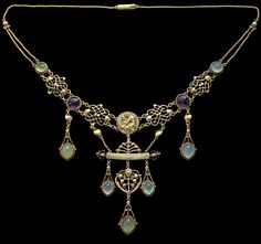 HENRY WILSON 1864-1934 The Apollo Necklace Gold Chalcedony Amethyst British, c.1904. This necklace was a gift to Lady Llewellyn-Smith and was commissioned by Sir Hubert Llewellyn-Smith from Henry Wilson.