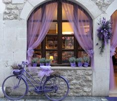 Lavander and white, curtains and a lot of flowers...