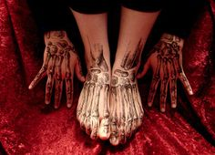skeleton hands and feet tattoo