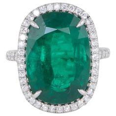 Fabulous Cushion Cut Green Emerald Platinum Ring
