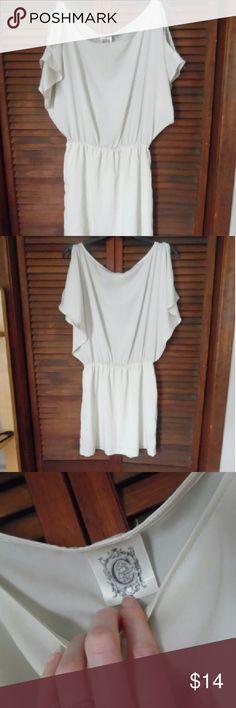 Cutout shoulder dress Cream cutout shoulder dress. Slight shimmer look to it. Elastic around waistline. Size medium Dresses Mini