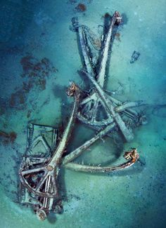 *NATIONAL GEOGRAPHIC ~ Davit pile: Titanic's lifeboats were hoisted overboard by davits, or small cranes. Most were ranked off the deck by flailing funnel cables. These two were entangled by ropes left dangling after a boat was launched.