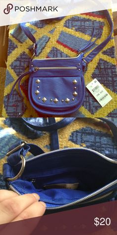 NWT Cobalt Crossbody American Rag nwt. Never used. No damage. Inner zipper pocket, outer zipper pocket and magnetic pocket. Silver stud details and hardware. American Rag Bags Crossbody Bags