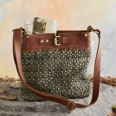 The 'Pressed Flowers' leather bag features an elaborate embossed pattern in a soothing, mellow hue.