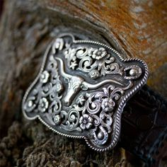 Clint Orms Josh 1801 - 1.5 sterling silver trophy buckle with hand cut filigree, figures and finished with diamond eyes.  Fits all1.5 belt straps.