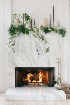 We feel inspired by this picture to create this warm ambient on a fireplace with our #CremaMarfil marble matched by #Greenery color, chosen by Pantone, do you like it? - picture from Pinterest.