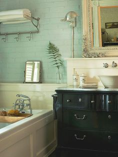 Pale blue, black and white create a relaxed color scheme for this classic bath. See the rest of this traditional home: http://www.bhg.com/decorating/decorating-style/traditional/small-traditional-home/?socsrc=bhgpin040413traditionalbath=9