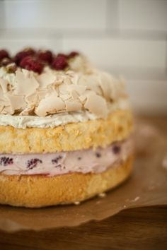 Raspberries & pistachio layer cake with Pavlova meringue on top.