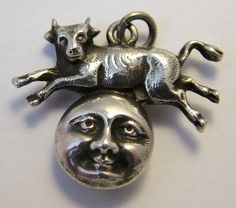 Victorian silver hollow cow jumping over the moon charm. www.sandysvintagecharms.com