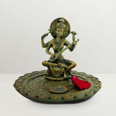 Gifts By Meeta Brass Goddess Saraswati Idol - Start your studies every day with this Goddess Saraswati idol from Gifts by Meeta. It looks stunning and will help you concentrate on studies. The idol has a golden hue thanks to its brass construction.