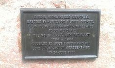 Plaque on Bydand statue