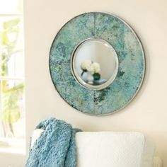 Not actually copper, but looks like aged copper. Verdigris Glass Mirror | Ballard Designs