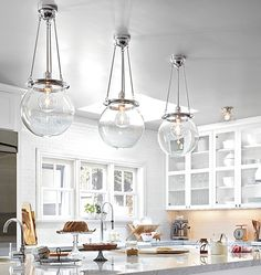 Love the light and airy and the idea of clear glass globe lights.