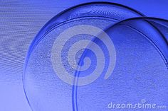 Abstract blue (purple tint) textured background crossed by overlapping circular arcs.