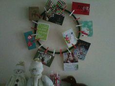 Homemade Christmas card wreath using clothes pins