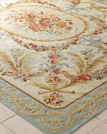 A lovely needlepoint rug. Usually formal & expensive, but they are so detailed they're like works of art.And wool rugs last almost indefinately.