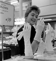 Trying on white gloves, 1962. #vintage #shopping #1960s