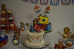 Caiden's cake table.   Cupcake toppers, towers and papers from Oriental Trading.
