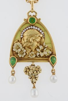 French Antique 18 karat Gold Enamel, Diamond, Peridot and Plique-a-Jour Juilet Pendant  A French Art Nouveau 18 karat gold pendant with diamonds, pearls and peridots. The pendant features a plique a jour background with rose-cut diamonds with an approximate total weight of .60 carats, 3 freshwater pearls and 3 pear and round -cut peridots with enamel decoration surrounding the profile of Juilet.  Circa: 1900