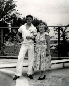"""Memphis, TN, Friday August 9, 1957: Actor Nick Adams (""""Rebel Without a Cause"""") and his mother, Catherine Adamshock (neé Kutz, April 17, 1010 – March 1995), visit Elvis and his parents at Graceland. Elvis wearing his monogrammed shirt and Nick's mom are pictured by the pool."""