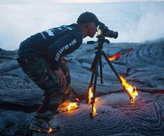 Daredevil photographer proves how far he will go for the perfect shot as his shoes and tripod are set alight by volcano lava flow. Kawika Singson was shooting in the volcanoes of Hawaii, which was so hot his tripod and shoes caught alight. Photos Du, Cool Photos, Crazy Photos, Interesting Photos, Amazing Pictures, Les Plus Vues, National Geographic Photographers, Foto Art, Chewbacca