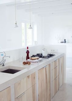 Light Pine and Finished Concrete Modern Kitchen