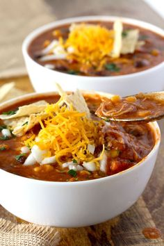 This Slow Cooker Chicken Enchilada Soup is bursting with flavor! Cheesy, creamy and full of shredded chicken, black beans and corn. With only 10 minutes of prep time this soup is pure comfort in a bowl! Best Slow Cooker, Slow Cooker Recipes, Crockpot Recipes, Cooking Recipes, Slower Cooker, Keto Recipes, Slow Cooker Potato Soup, Slow Cooker Chicken, Cooked Chicken
