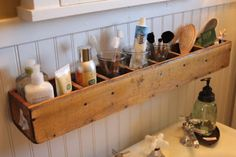 BATHROOM CUBBIE - Make the most of storage for small bathrooms! Hang a divided box onto the wall above the sink & below the mirror. Place lotions, hair or tooth brushes, jars of rubber bands or cotton balls, etc in them! Leave unfinished for a country look or paint/stain to match your decor!