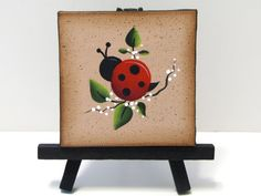 Ladybug Mini Canvas on Easel, Handpainted, Home Decor,  Shelf Sitter. $8,95, via Etsy.