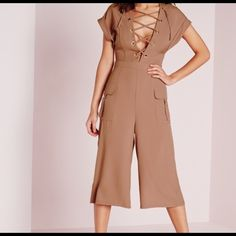 Missguided Lace up Culotte Jumpsuit Blush Blush lace up Culotte jumpsuit with roll sleeves. Color is more of a pinkish tone in person. Pocket details on the side. In new condition. Missguided Makeup Blush
