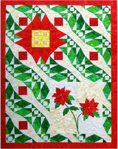 Poinsettia quilt at Barbara Bieraugel Designs: Christmas in August.  Storm at Sea pieced background with poinsettia applique.