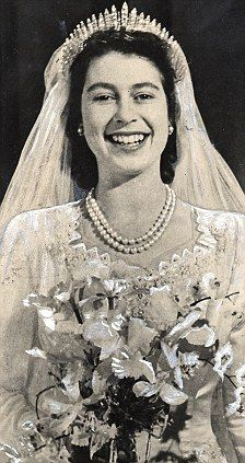 Elizabeth on her wedding day wearing the Queen Mary fringe tiara, not - as…