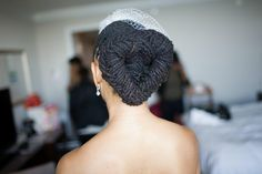 The most amazing braided loc bun I have ever seen! It's heart-shaped! Photo by Dante Williams Photography, used by permission.