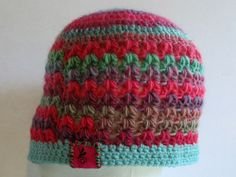 BlueBear Original V-Stitch Rainbow and Pink Crochet Beanie Hat. This darling V-stitch hat is great for your warmer weather. It allows airflow through which lets your head keep warm but still breathe. The vibrant colors are sure to get you noticed and you will love how soft and floppy it is. It is great for warmer winter days too, or just to wear as a fashion accessory. This is going to be your next favorite hat. Enjoy! Live Life In Color!!.