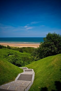 """View down costal path from the American Cemetery, Normandy, France. You can see Omaha beach on the horizon. This beach is also known as """"Bloody Omaha"""" because of the casualties suffered by the American troops who landed here on D-Day. Belle France, France 3, Paris France, Provence France, Places To Travel, Places To See, Great Places, Best Vacation Destinations, Best Vacations"""