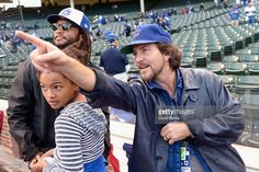 Musician Eddie Vedder (right) watches batting practice with former Major League Baseball player Darnell McDonald and his daughter Jiana McDonald prior to game three of the National League Division Series between the Chicago Cubs and the St. Louis Cardinals at Wrigley Field on October 12, 2015 in Chicago, Illinois.