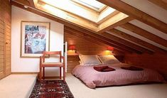 Fancy wooden attic bedroom