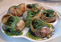 Escargots are also known as snails.  This way of preparing escargot uses lots of butter, garlic, and parsley!